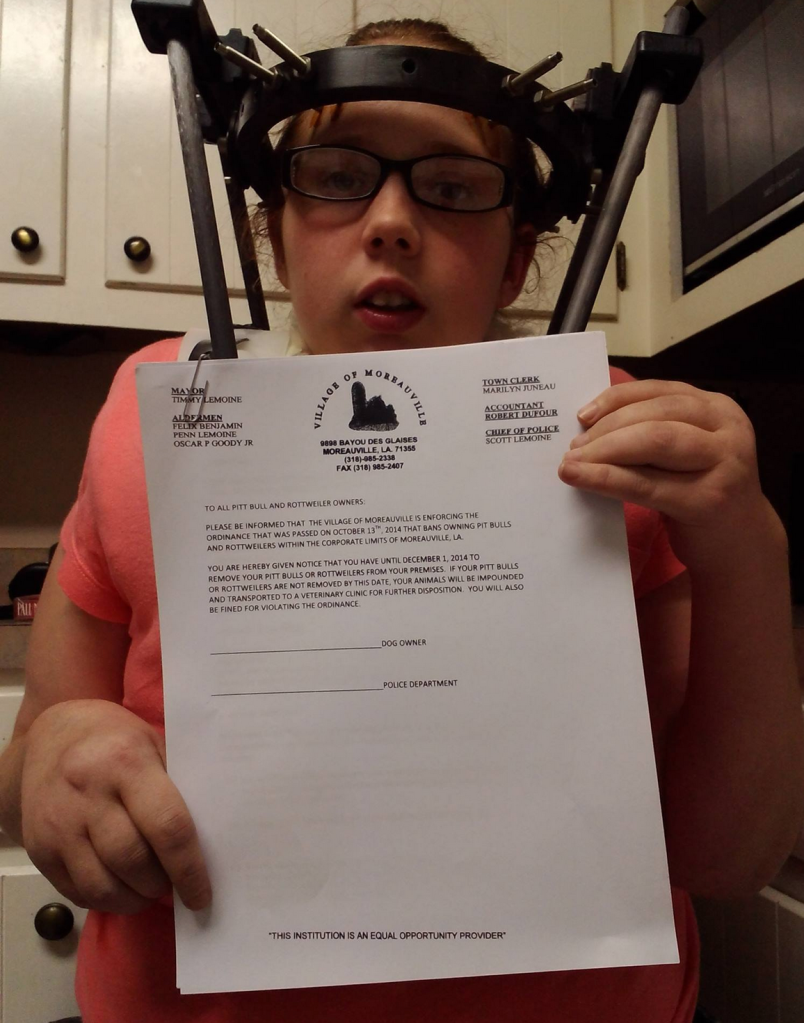 Zeus's owner holding up the demand letter she received from Moreauville.
